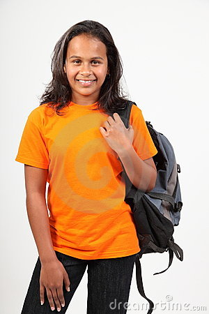 Young happy primary school girl with back pack