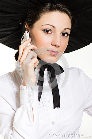 Young happy smile elegant woman with mobile phone wearing black & white Victorian style dress & hat