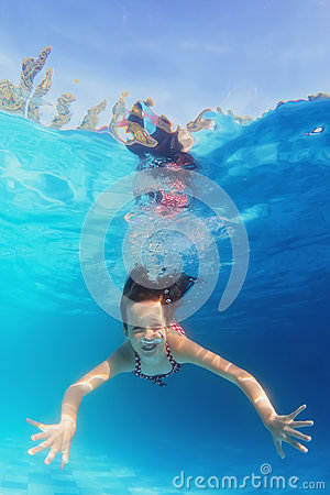 Free Young Happy Smiling Child Swimming Underwater In The Blue Pool Royalty Free Stock Images - 54529599