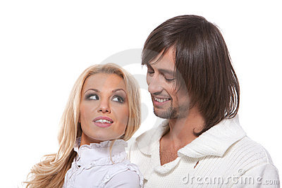 Young happy smiling couple looking at each other
