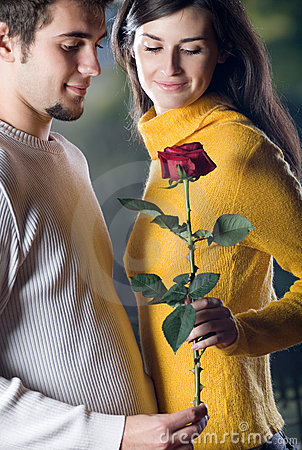Free Young Happy Smiling Couple With Rose On Romantic Date Royalty Free Stock Image - 1925066