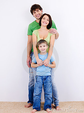 Free Young Happy Smiling Family Looking At Camera Stock Photos - 12147123