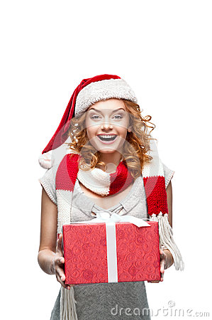Young happy smiling girl holding christmas gift