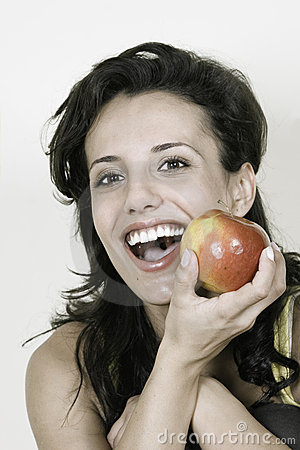 Young happy smiling woman with red apple