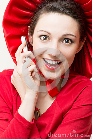 Young happy surprised woman in red with mobile phone
