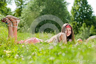 Young happy teenage girl with apple outdoors