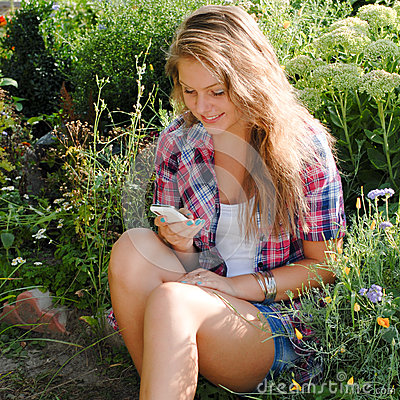 Free Young Happy Teenage Girl Using Mobile Phone Royalty Free Stock Photography - 28208867