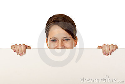 Young happy woman behind blank advertisement board