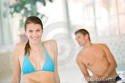 Young happy woman in bikini relax in spa