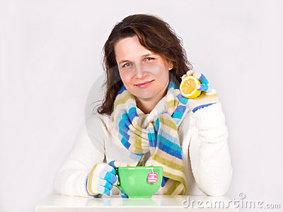 Young happy woman drinking hot tea