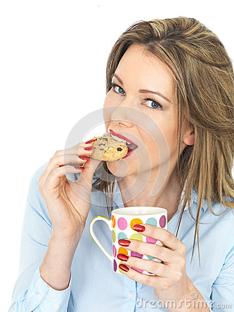 Free Young Happy Woman Enjoying Tea And Biscuits Stock Image - 52024171