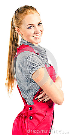Young happy woman in red overalls