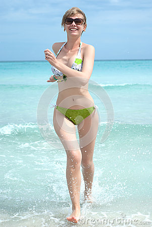 Free Young Happy Woman Running From The Ocean Royalty Free Stock Images - 19701349