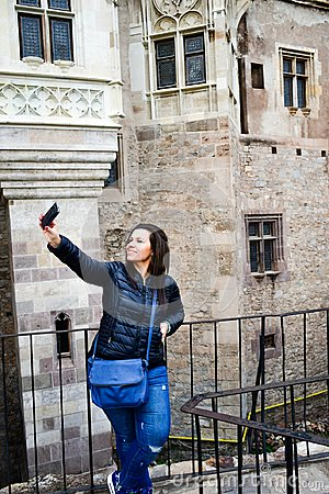 Free Young Happy Woman Taking A Selfie At Corvin Castle, Romania Royalty Free Stock Image - 103607396