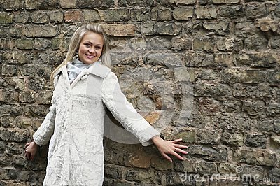 Young Happy Woman In White Fur Coat