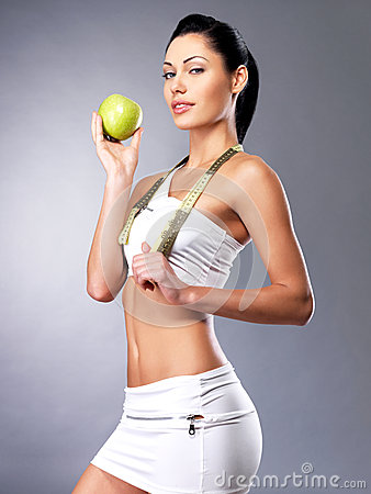 Young healthy woman with apple