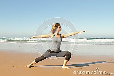 Young healthy woman doing yoga exercises