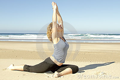 Young healthy woman doing yoga exercises