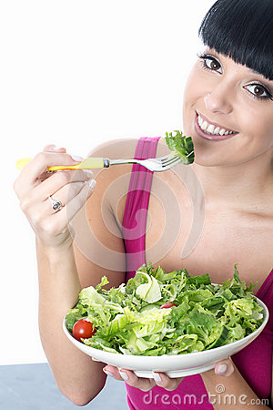 Free Young Healthy Woman Eating A Fresh Bowl Of Green Salad Leaves Stock Image - 54864181