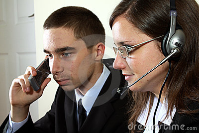 Young help desk specialists in work