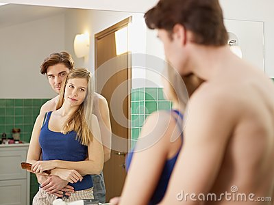 Young heterosexual couple in bathroom