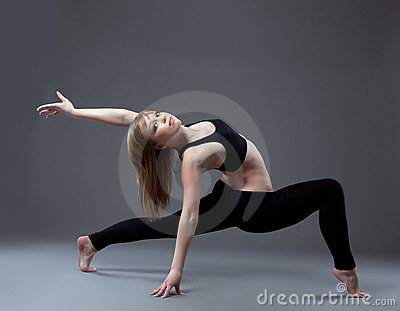 Young high skill acrobat posing in dance