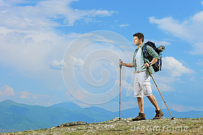 A young hiker with backpacker hiking in the mountain