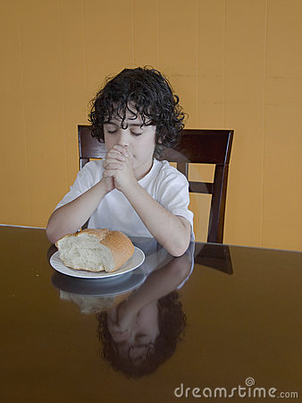 Young Hispanic Boy Praying for the Food