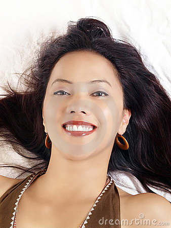 Young hispanic woman with big smile reclining