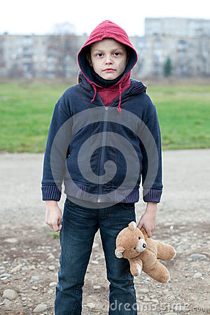 Free Young Homeless Boy On The Street With Bear Stock Photo - 35311110
