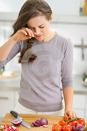 Free Young Housewife Crying While Cutting Onion Stock Image - 29695481