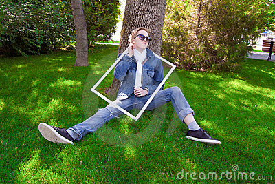 Young human on the green grass
