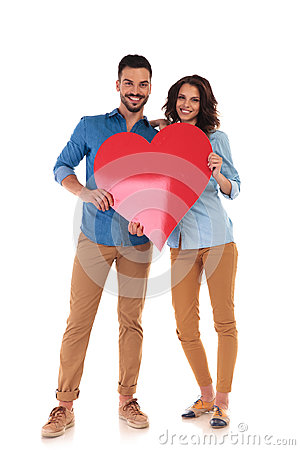 Free Young In Love Couple Holding Big Red Heart Stock Photo - 99189560