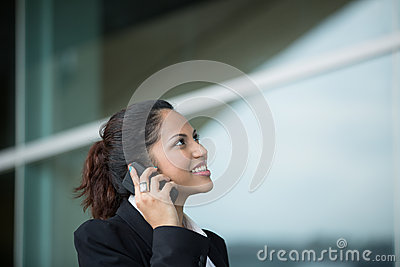 Young Indian business woman using mobile phone.