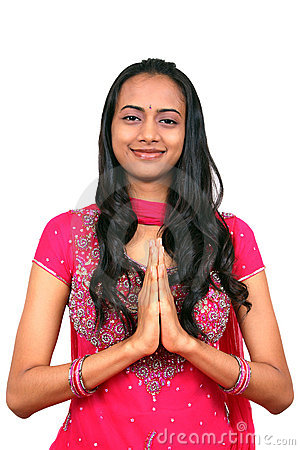 Young Indian girl in namaste pose.