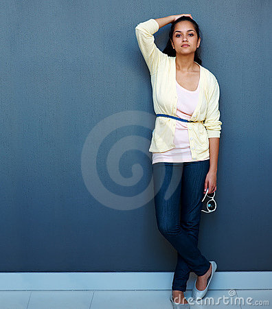 Young Indian girl posing against grey background