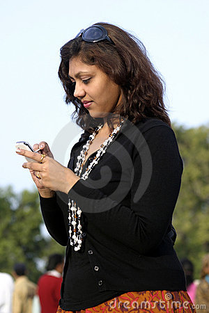 Young Indian girl using mobile phone