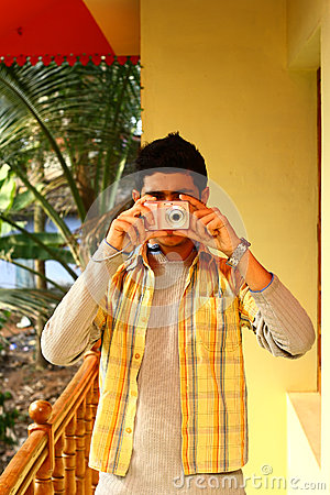 Young Indian Man Taking Photograph in P&S Camera