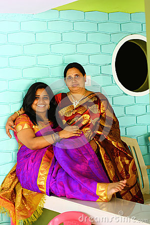 Young Indian Mother And Daughter In Saree Stock Photos