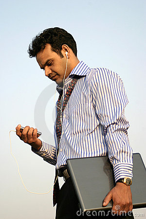 Young indian using mp3 player