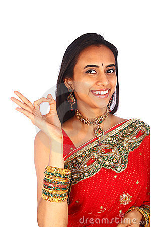 Young Indian woman with Ok gesture.