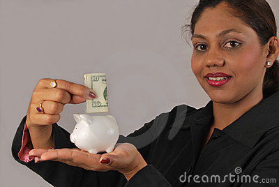 young Indian woman saving money