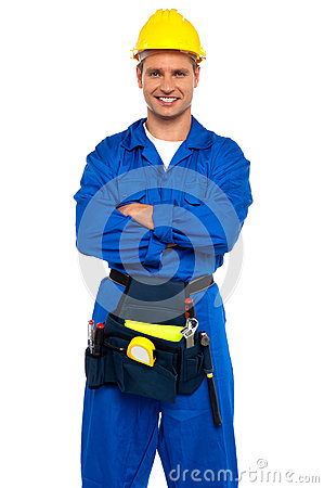 Young industrial contractor posing