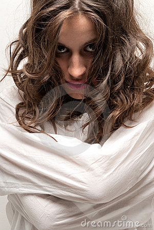 Young insane woman with straitjacket looking