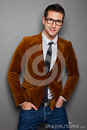 Young interesting businessman with rimmed glasses