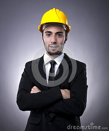 Young investor with construction helmet