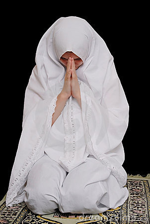 Young islamic girl wearing hijab and pray