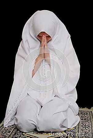 Young islamic girl wearing hijab and pray
