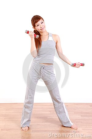Young Japanese woman doing dumbbell exercises
