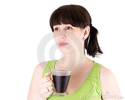 The young joyful woman drinks coffee